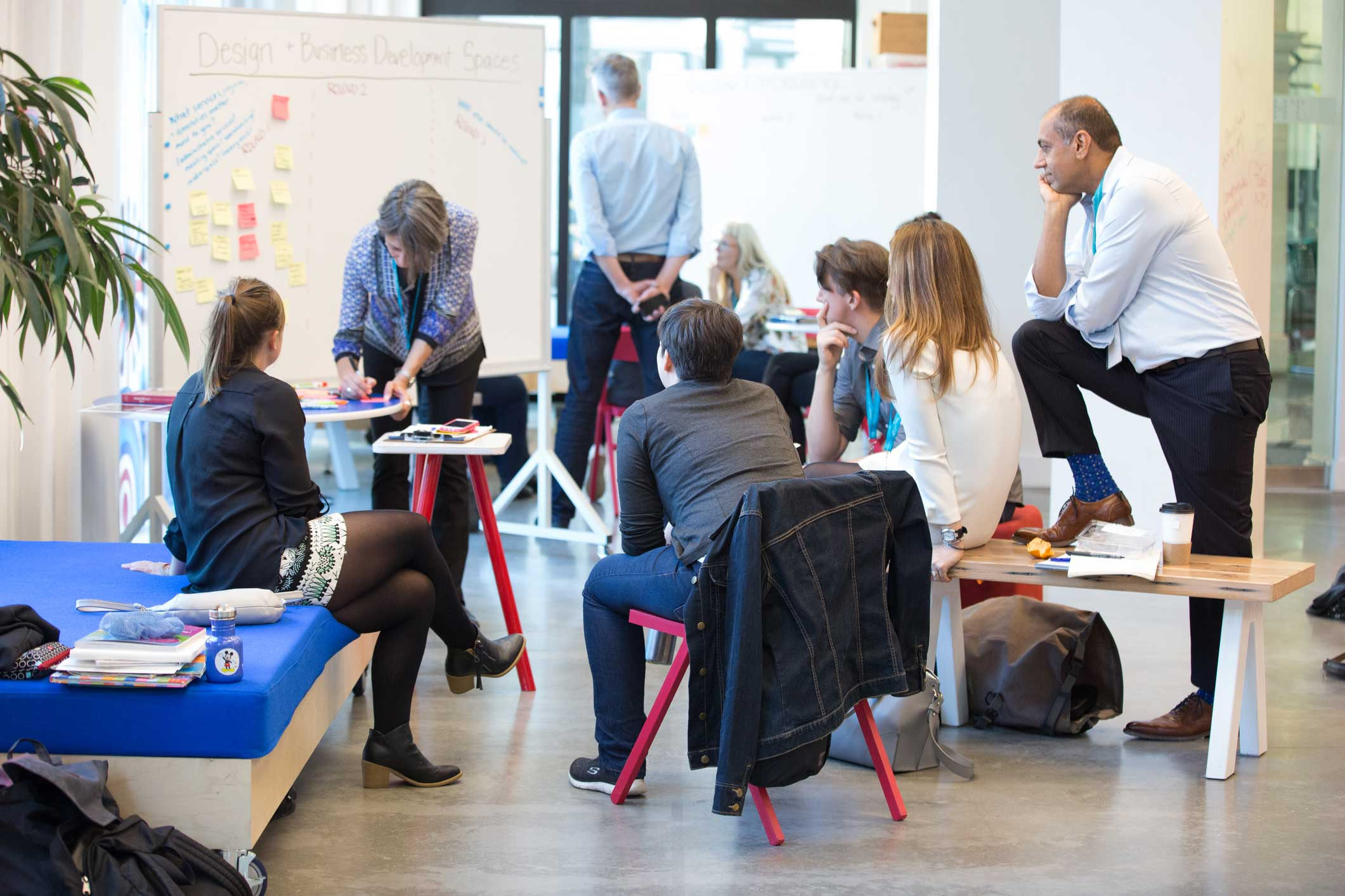 Group of people brainstorming in a light filled room.